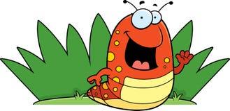 Caterpillar Grass. A happy cartoon caterpillar in the grass Stock Photos