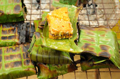 Caterpillar and honeycomb grilled on the coaster Royalty Free Stock Image