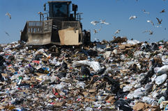Caterpillar in landfill Stock Photos