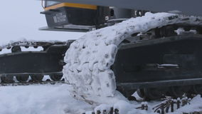 Caterpillar Track of Machinery Moves in Snow stock footage