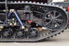 Caterpillar tractor close-up. Chassis tractor caterpillar black close-up stock image
