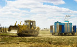 Caterpillar tractor pulling power station at the production site Stock Image