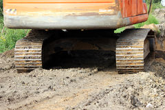Caterpillars of heavy construction equipment crawler excavator on the site for the expansion the road. Stock Photo