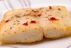 Catfish filet on a plate royalty free stock images