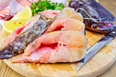Catfish raw with knife on board Royalty Free Stock Photography
