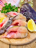 Catfish raw with lemon on board Stock Images
