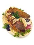 Catfish or sheatfish with lemon and parsley Royalty Free Stock Image