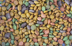 Catfood background. Background of mixed colored dry cat food Stock Photography
