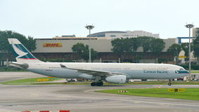 Cathay Pacific Airbus 330 taxiing at Changi Airport Royalty Free Stock Photo