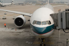 Cathay Pacific aircraft near boarding bridge Stock Photo