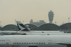 Cathay Pacific aircraft near boarding bridge Stock Photography