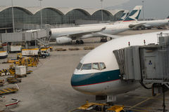 Cathay Pacific aircraft near boarding bridge Royalty Free Stock Photo
