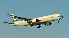 Cathay Pacific Boeing 777 landing at Changi Airport Royalty Free Stock Photo