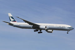 Cathay Pacific Boeing 777 in New York sky before landing at JFK Airport Stock Images