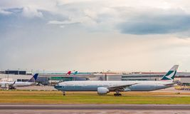 Cathay Pacific at Heathrow. LONDON, UK - October 1, 2016: Heathrow Airport is the second busiest airport in the world by international passenger traffic, as well royalty free stock photography
