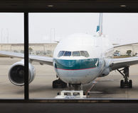 Cathay Pacific passenger airplane at the airport Royalty Free Stock Images