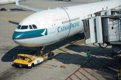 Cathay Pacific plane. HONG KONG, CHINA - SEPTEMBER 17:  Cathay Pacific plane waits in Hong Kong International Airport on September 17, 2012. Cathay Pacific Royalty Free Stock Images