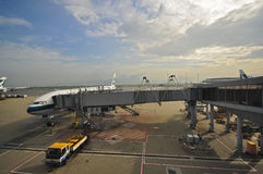 Cathay Pacific plane loading/unloading Royalty Free Stock Photo