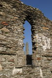 The Cathedral. Ruin with the Round Tower framed in the window opening at Glendalough Monastic Site - Wicklow Mountains National Park royalty free stock photos