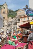 The Cathedral of Amalfi and the tourists. The façade of the Amalfi Cathedral on the Amalfi coast and the tourists royalty free stock photos