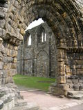 Through the Cathedral Arch. Looking Through the Stone Arch of St. Andrews Cathedral Ruins in Scotland Royalty Free Stock Photography