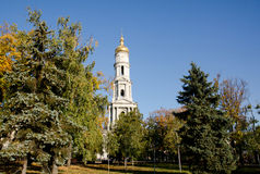 Cathedral of the Assumption in Kharkov, surrounded by trees on the background of a cloudless sky Royalty Free Stock Photos