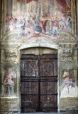 Cathedral of Asti, interior. Asti (Piedmont, Italy) - Interior of the historic cathedral, fresco, door and rose window Stock Image