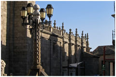 Cathedral of Avila. Exterior of Cathedral of Avila with old street lamps in foreground, Old Castile, Spain Stock Image