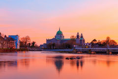 Cathedral on the bank of the river during sunset Royalty Free Stock Photography