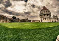 Cathedral, Baptistery and Tower of Pisa in Miracle square. Italy Royalty Free Stock Photography