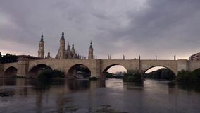 Cathedral Basilica Our Lady of Pillar with bridge and Ebro river at Zaragoza