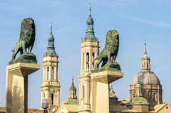 Cathedral-Basilica of Our Lady of the Pillar and two statues of lions Royalty Free Stock Image