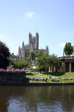 Cathedral in bath UK. Stone Cathedral in bath UK with arch's and windows with a park and river in front Royalty Free Stock Photos