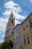 Cathedral belltower against clouds and the sky to Lisbon, Portugal Royalty Free Stock Photos