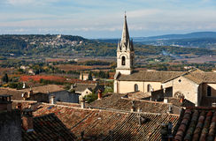 Cathedral of Bonnieux and Lacoste village Royalty Free Stock Photos