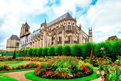 The Cathedral of St Etienne of Bourges, beautiful garden, France. Cathedral in Bourges, beautiful garden France. Sunny day. UNESCO World Heritage List royalty free stock image