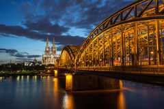 Cathedral and Bridge in Cologne Stock Photo