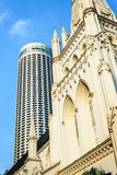 The cathedral and The Building. St Andrew s Cathedral and Swissotel the Stamford in Singapore Royalty Free Stock Image