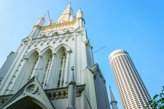 The cathedral and The Building. St Andrew s Cathedral and Swissotel the Stamford in Singapore Royalty Free Stock Images