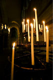 Cathedral Candles. Offering candles lighting up a dark cathedral in france Royalty Free Stock Images