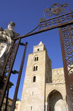 Cathedral of Cefalu. A tower of the medieval Cathedral of Cefalu framed in an iron gate. Cefalu, Sicily, Italy royalty free stock photo