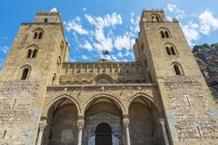 Cathedral of Cefalu in Sicily, Italy. Facade of the cathedral of Cefalu, of style called Sicilian Romanesque, in Sicily, Italy Stock Images