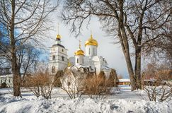 Cathedral and chapel with golden domes. In Borisoglebsky monastery in Dmitrov on a winter sunny day stock photos