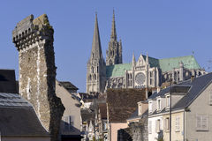 Cathedral of Chartres in France. Cathedral Notre-Dame of Chartres with old vestige of the Porte Guillaume. Chartres is a commune and capital of the Eure-et-Loir Royalty Free Stock Photography