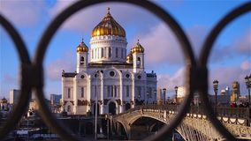 Cathedral of Christ the Savior in Moscow through frame of fence of bridge over Moscow river stock video footage