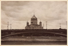Cathedral of Christ the Saviour and Bolshoy Kamenny Bridge. Moscow, Russia. Cathedral of Christ the Saviour and Bolshoy Kamenny Bridge. Stylized as an old photo royalty free stock image