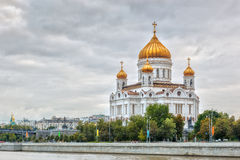 Cathedral of Christ the Saviour in Moscow, Russia. View to the Cathedral of Christ the Saviour under heavy clouds over river Moscow, Russian Federation Stock Photo