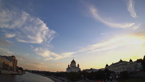 The Cathedral of Christ the Saviour at sunset. Soft white and gray clouds are transforming and moving across the blue sky. Fisheye stock video