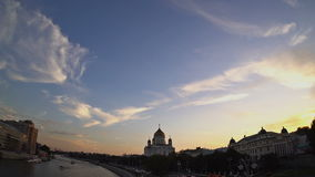 The Cathedral of Christ the Saviour at sunset. Soft white and gray clouds are transforming and moving across the blue sky. Fisheye stock footage