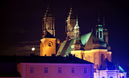 Cathedral Church in Poznan at night with moon Stock Image